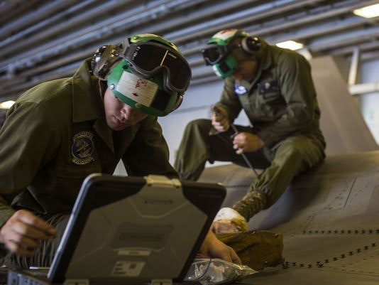 Cpl. Kendal Parish and Sgt. Arben Kupa, airframe mechanics from Marine Fighter Attack Training Squadron 501, reinstall a panel of an F-35B Lightning II after maintenance aboard a ship. (Photo: Pfc. Remington Hall/Marine Corps)